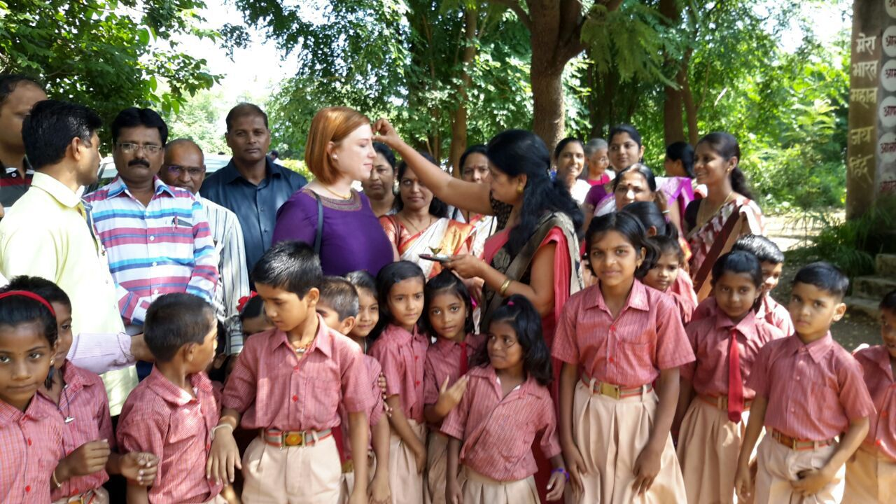the lead teacher Mukti placing a bindi on Erica